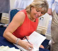 Penny Power signing her book at the book launch